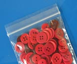 Lock Top Zip ® Bags red buttons close